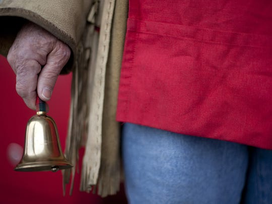A Salvation Army bell ringer solicits donations to