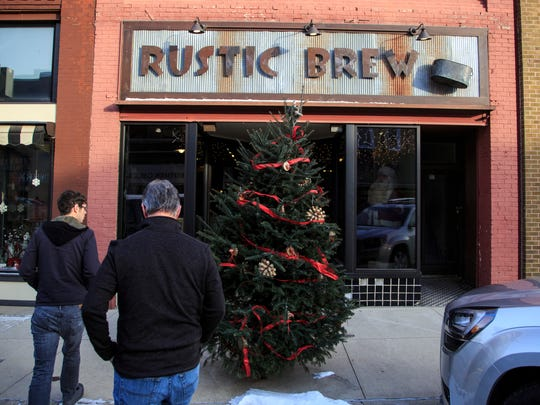 Marc Bailey and his father Clint arrive at Rustic Brew in Hampton Thursday, Dec. 15, 2016.