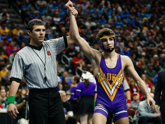 Waukee's Kyle Biscoglia celebrates a 9-2 win over Ankeny Centennial's Ben Monroe during their class 3A 120 pound championship match at Wells Fargo Arena on Saturday, Feb. 17, 2018, in Des Moines.