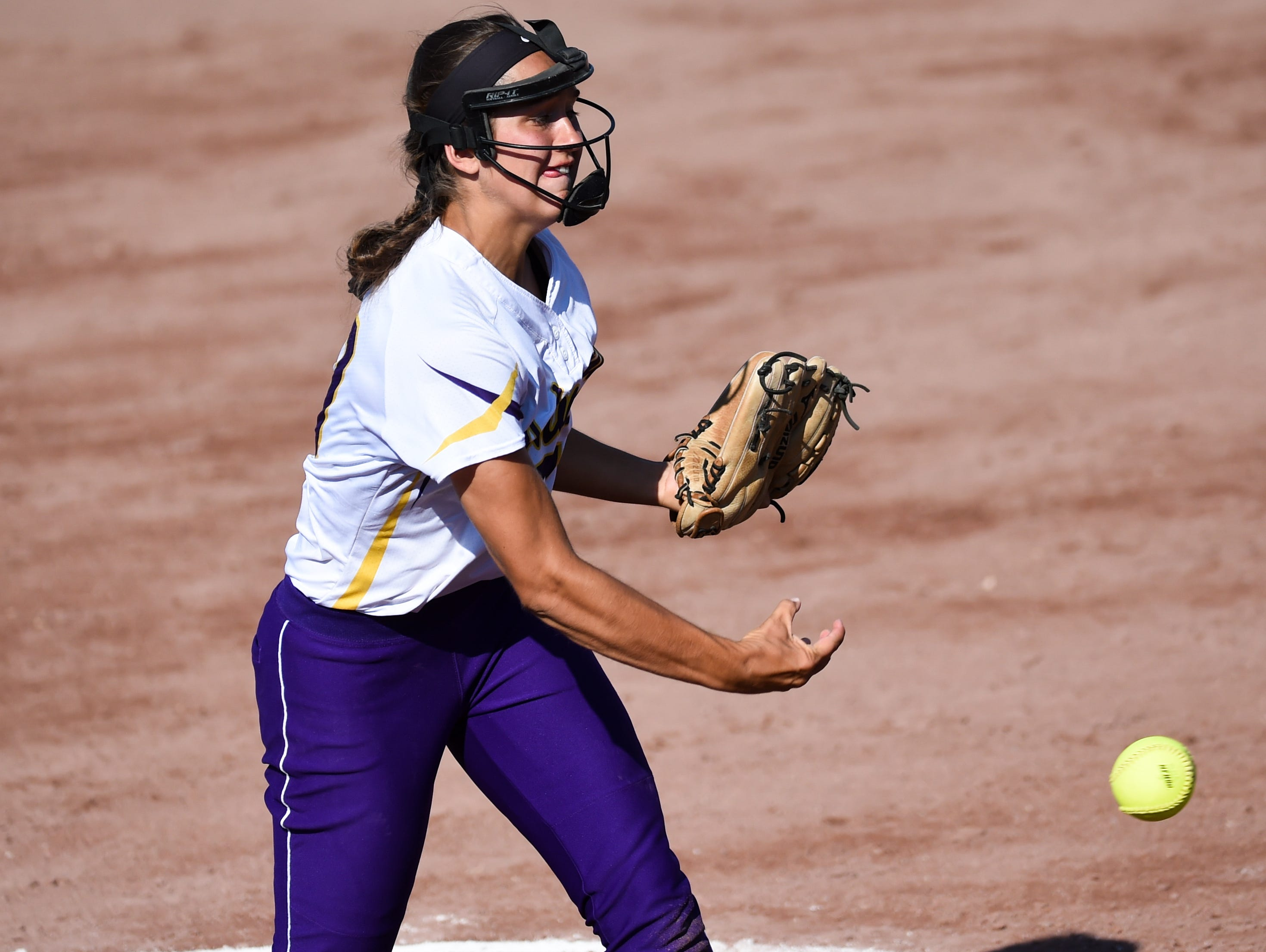 Johnston pitcher Haylee Towers (13) fires in a pitch on Thursday, July 23, 2015, during the Class 5-A semifinals.