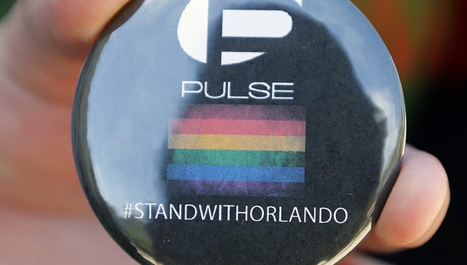 These buttons were given out during out during Monday's vigil, which was sponsored by UC's LGBTQ Center.