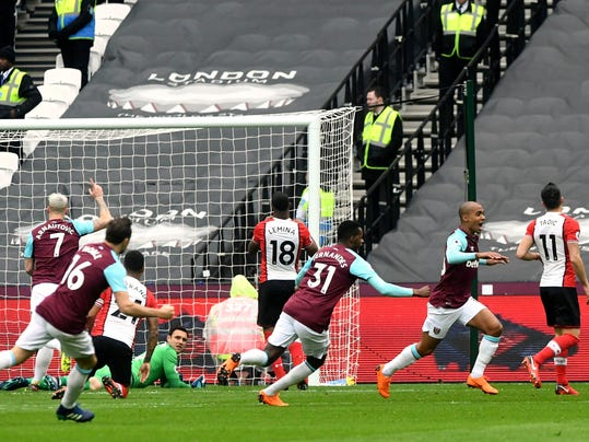 West Ham United's Joao Mario, second right, celebrates scoring his side's first goal of the game during their English Premier League soccer match against Southampton at the London Stadium in London, Saturday, March 31, 2018. (Victoria Jones/PA via AP)
