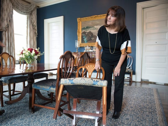 Second Lady Karen Pence  shows a  chair which is part