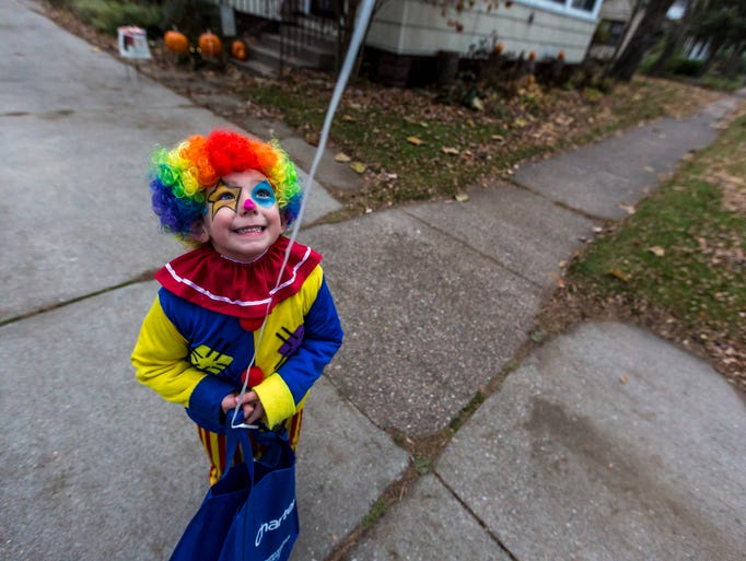 Zach Zelewski, 4, goes trick-or-treating as a clown