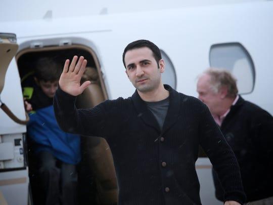 Former U.S. Marine Amir Hekmati, 32, arrives at Bishop International Airport on Thursday, Jan. 21, 2016, in Flint.