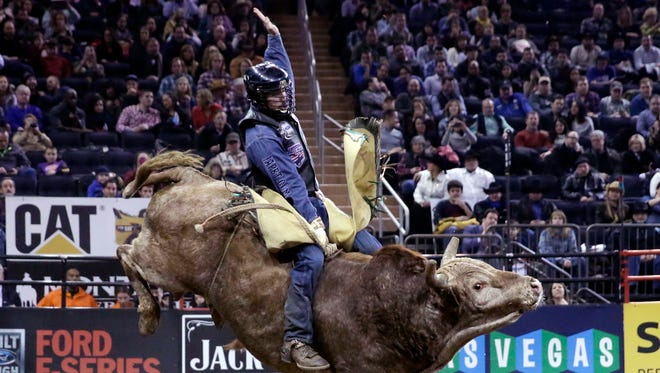 Eduardo Aparecido, from Decatur, Texas, rides Dirty Deal during the Professional Bull Riders Buck Off on Jan. 17.