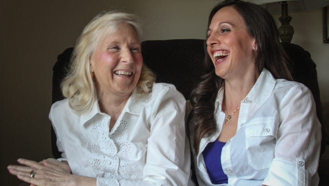 Andrea Raymond shares a laugh with her daughter Kristen. Andrea battled ovarian cancer for almost six years.