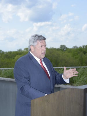 Bill Freeman speaks from the green roof of his company