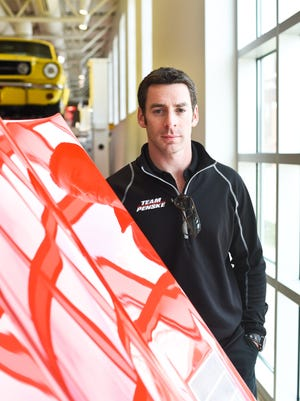IndyCar driver Simon Pagenaud of Team Penske poses by the lifted hood of a 1963 Chevrolet Corvette while visiting The Automobile Gallery between interviews. He was in town to promote the Verizon IndyCar Series Road America Grand Prix, which will be held June 24-26 in Elkhart Lake.