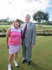 Port St. Lucie Sunset Rotary President Jeannette Weiss with membership chair Jack Lutz, membership Sales Manager PGA Golf Club