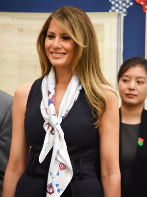 First Lady Melania Trump visits the the Bak Middle School of the Arts, with the People's Republic of China First Lady Peng Liyuan (not shown) on April 7, 2017 in West Palm Beach, Fla.