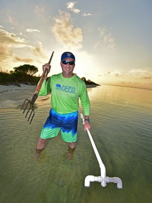 Matt Merritt hits the shoreline with his gig and LED light hoping to bring home a bounty of flounder.