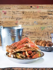 Small platter with snow crab, shrimp, crawfish, clams and  mussels.