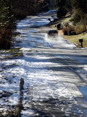 Snow and ice still cover some shaded streets like Tierra Verde Drive in West Knoxville on Friday, Jan. 19, 2018.