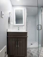 The flood ended in the basement, home to this redesigned bathroom