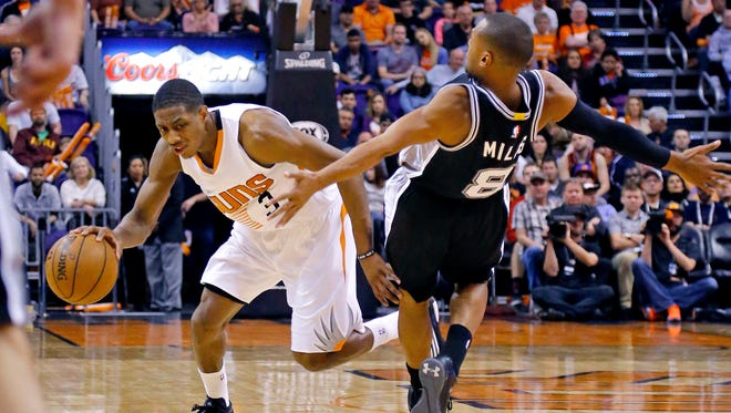 San Antonio Spurs guard Patty Mills (8) is called for a foul against Phoenix Suns guard Brandon Knight (3) during the first half of their NBA game on Feb. 28, 2015, in Phoenix.
