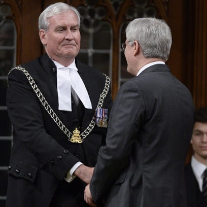 Prime Minister Stephen Harper shakes hands with as