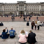 Tourists around Buckingham Palace in London, Thursday, May 19, 2016.