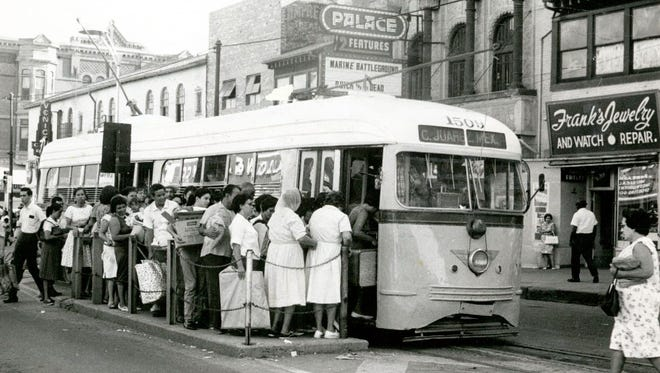 People wait in line to board the El Paso streetcar in this undated photo.
