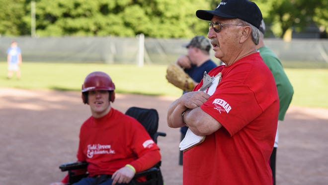 Neenah's Gib Mueller coaches a team in the Discovery League in Neenah. Mueller has been volunteering with the organization for more than 30 years.