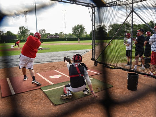 Rocori baseball players take batting practice Tuesday,