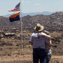 David and Shari Turbyfill take time to reflect at the site where their son Travis Turbyfill was killed during the Yarnell Fire.