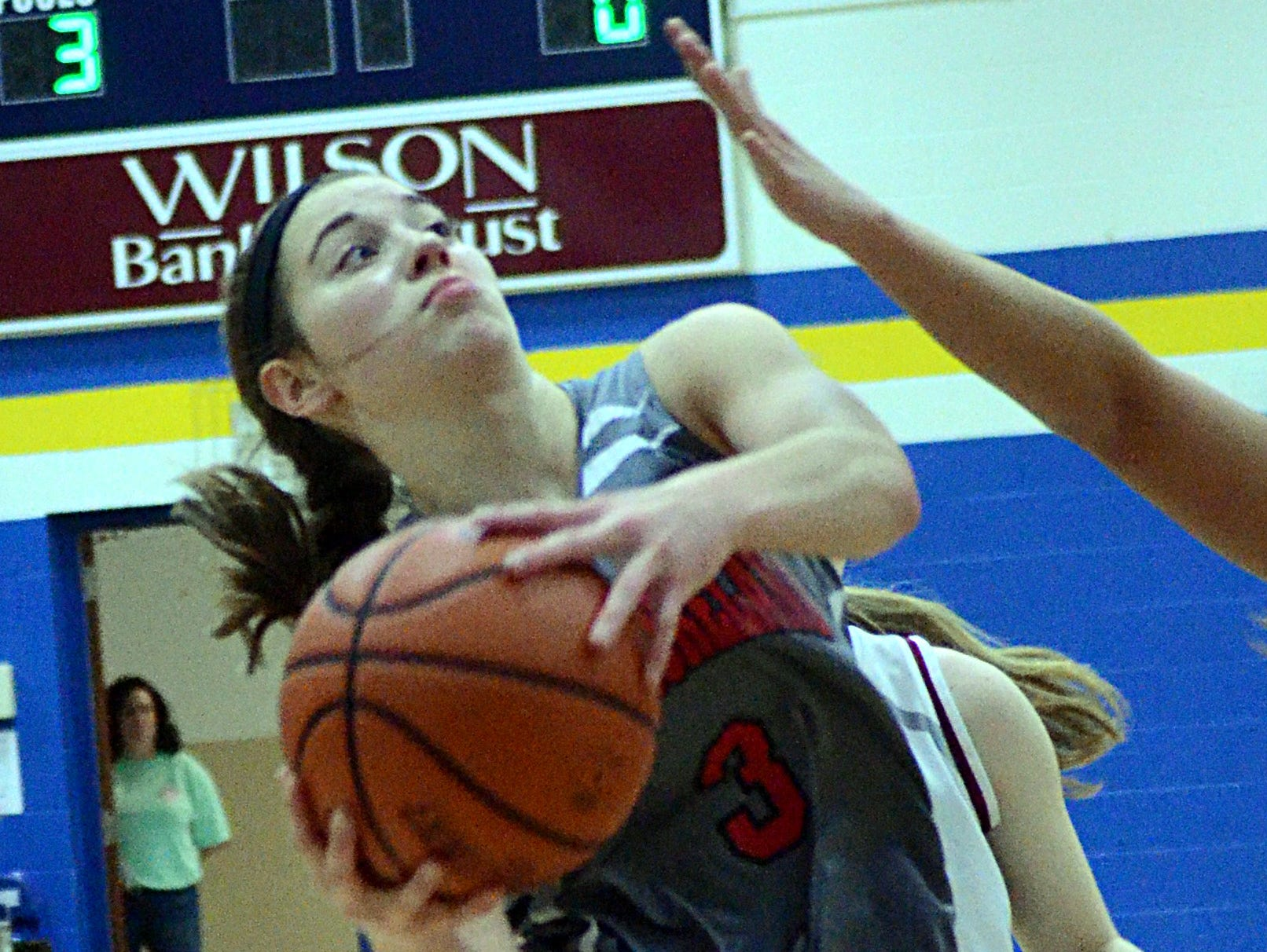 Westmoreland High junior guard Gracie Oliver elevates for a first-quarter shot in the lane. Oliver scored three points.