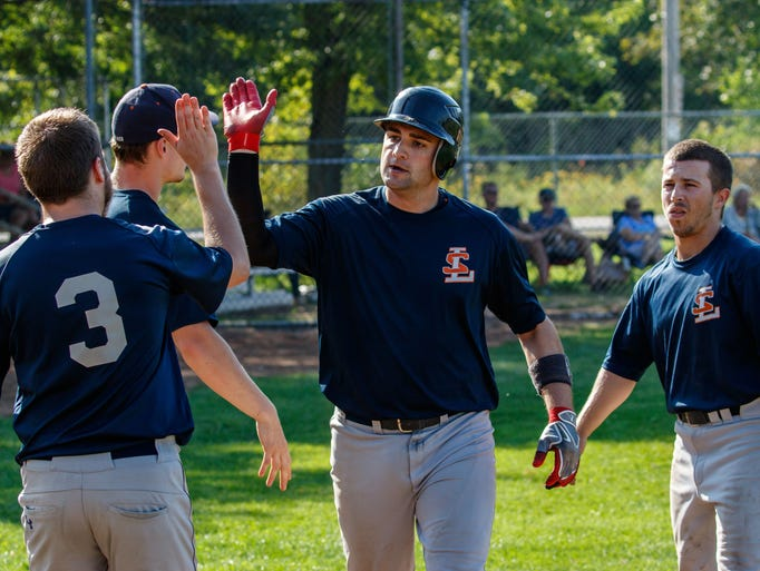 Lannon's Brett Krause (center) get's a high-five from