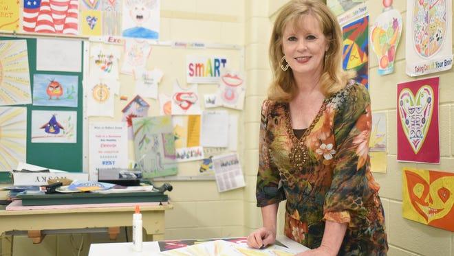 Hattiesburg art teacher Diane Ellzey received a Lifetime Achievement Award for her 31-year career in education.