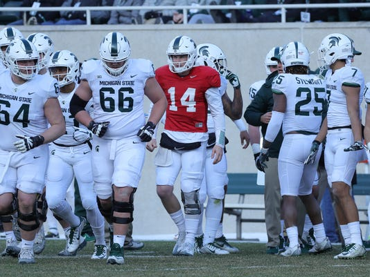 Brian Lewerke, Michigan State takes the field