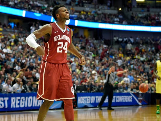 Oklahoma guard Buddy Hield celebrates after scoring during the first half of an NCAA college basketball game against Oregon in the regional finals of the NCAA Tournament, Saturday, March 26, 2016, in Anaheim, Calif. (AP Photo/Mark J. Terrill)