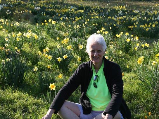 Claire White in daffodils