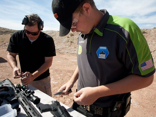 Brian Nelson, right, and his father, Ken Nelson, load magazines in preparation for target practice on the practical shooting range at the Southern Utah Shooting Sports Park Wednesday, April 18, 2012 in Hurricane.