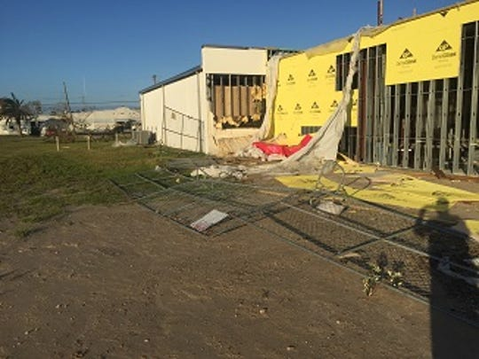 "Part of the William R. ""Bill"" Ellis Memorial Library shows signs of damage shortly after Hurricane Harvey made landfall in nearby Aransas County in late August."