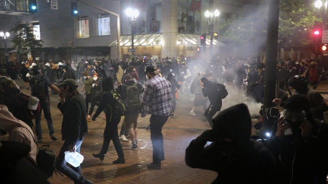 Police used tear gas and stun grenades on a group of protesters in downtown Portland.