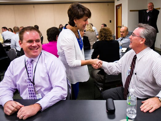 New Gilbert Schools superintendent Christina Kishimoto meets with principals , including Towne Meadows Elementary principal Chip Pettit, left, and Burk Elementary principal Brad Paes, at a breakfast in Mesa, Wednesday, April 2, 2014. The district has been in turmoil recently with a rash of top-level resignations.