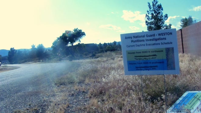 Signs posted in Winchester Hills alerted residents to a planned search for weapons munitions in this photo from Sunday.