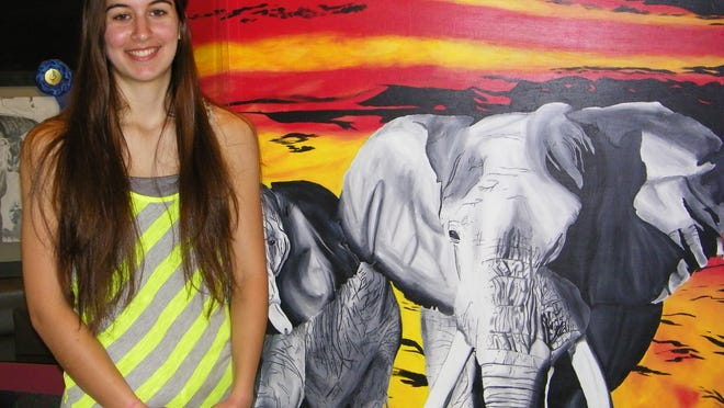 Erin Luckey, with her painting of elephants, won an honorable mention at the Five County Invitational Art Show in April. Luckey has developed into an exceptional artist after only three years of taking classes from art teacher Jodie Peace at Woodmore High School.