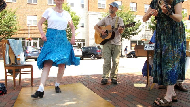 Ann Whiting of Colchester performs French-Canadian step-dance Saturday in Colchester. Performing with her is guitarist David Guertin of Cornwall and Lausanne Allen of South Starksboro.