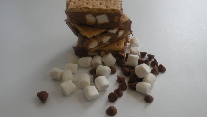 Peanut Butter S'mores bars are perfect for when you want to eat a s'more without lighting a campfire. These bars are rich, creamy and decadent and will satisfy any sweet tooth. The bars use the typical s'mores ingredients (graham crackers, chocolate and marshmallows) and adds peanut butter.