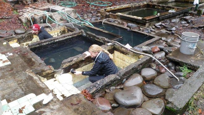 Volunteers scrub the tubs at Lower Breitenbush Hot Springs.