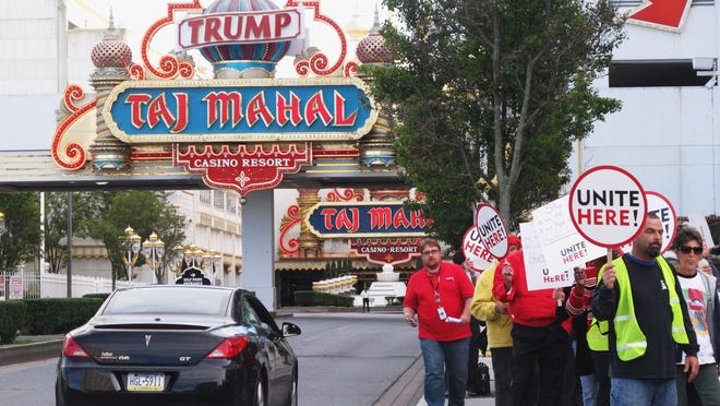 In this Oct. 24, 2014 photo, casino union workers demonstrate outside the Trump Taj Mahal Casino Resort in Atlantic City against the court-ordered termination of their health care and pension plans. An appeals court ruled Jan. 15, 2016, that Atlantic City's Trump Taj Mahal casino was within its rights to end health insurance and pension benefits to its workers, removing the last major obstacle to billionaire Carl Icahn taking over.