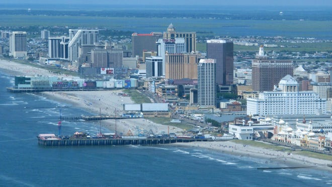 This July 11, 2014 aerial photo shows the Atlantic City N.J. beachfront with many of its Boardwalk casinos. On Tuesday Jan. 26, 2016, Chris Christie, a Republican presidential candidate, along with the state senate president and Atlantic City mayor, unveiled a state takeover of Atlantic City's finances and decision-making power to help rescue it from a financial morass.