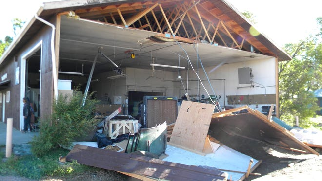 The south wall of the Poplar Body Shop collapsed because of 85 mph sustained winds during the severe thunderstorm that hit the Poplar area Friday night