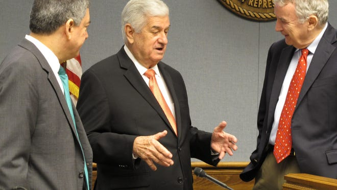 Senate President John Alario, R-Westwego, center, speaks with Commissioner of Administration Jay Dardenne, left, and LSU economist Jim Richardson in Baton Rouge, ahead of a meeting of the state income forecasting panel. The governor appears to be relying more heavily on ideas from the Legislature this year. He had a meeting last week with Alario and House Speaker Taylor Barras and all walked away agreeing to explore different ideas.