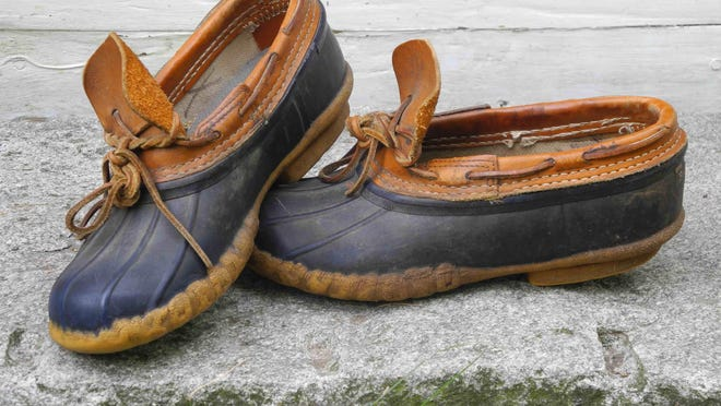 """My trusty """"gum"""" shoes keep my feet dry, and are easy to slip off after rinsing with a hose."""