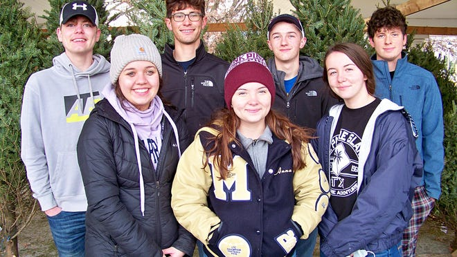 The Exchange Club of Aledo was fortunate to have seven Mercer County High School students assist with the unloading, tagging, unwrapping and displaying of their Christmas trees on Saturday morning, November 21, 2020.  Front (left to right)---Kierstin Benson, Anna Wagner, and Katie Wagner.  Back (left to right) Collin Lininger, Robbie Holtschlag, Carson Holmes, and Gage Lager.  These young volunteers made a big impact on Exchange's community project.