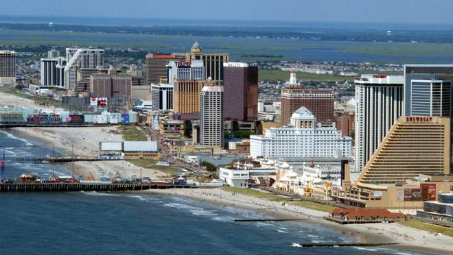 Atlantic City officials voted Wednesday on a package of steep spending and job cuts to help get its finances under control and attract new aid from the state government.