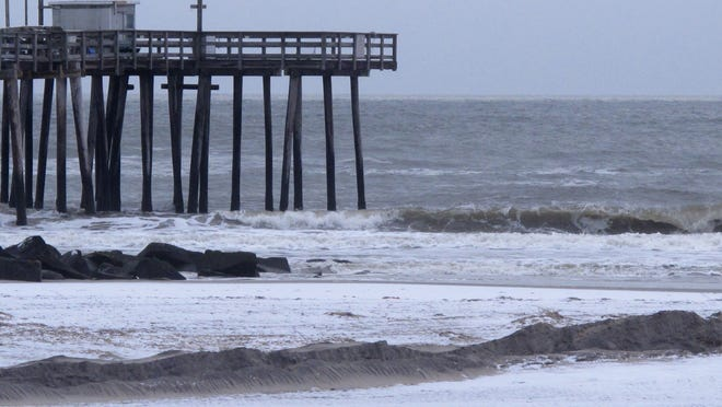 This Jan. 14, 2015 photo shows a fishing pier on the beachfront in Margate, a New Jersey shore town which opposes dunes and is fighting the state's plan to erect them in Margate to protect against major storms. A federal judge said on Thursday Jan. 15, 2015 that the state did not appear to give private property owners the right to challenge the confiscation when it seized the land by executive order. Margate claims its bulkheads are sufficient to protect against storms and that dunes are not needed.(AP Photo/Wayne Parry)