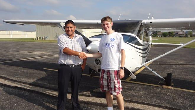 William Sanders, right, of Hebron, took his solo flight in August.